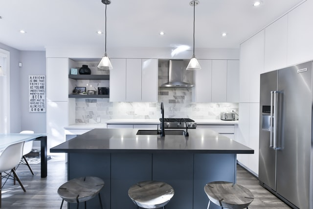 White kitchen with many reflective surfaces