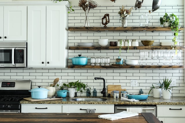 Open shelves in a kitchen with subway tiles